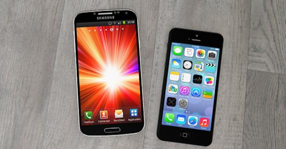 Samsung mobile phone and iPhone on a table © Pedro II/Shutterstock.com