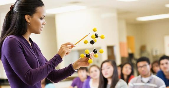 Science teacher in class | Jon Feingersh/Getty Images