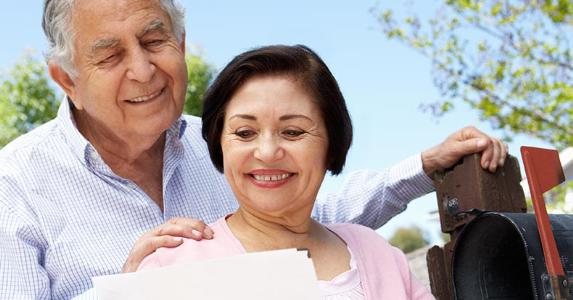 Senior couple checking mailbox | Monkey Business Images/Shutterstock.com