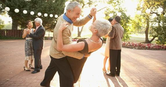 Senior couple dancing in outdoor party | Blend Images/Plush Studios/Bill Reitzel/Getty Images