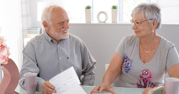 Senior couple looking pleased © StockLite/Shutterstock.com