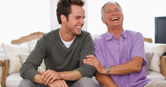 Senior father laughing with son | Daly and Newton/OJOImages/Getty Images