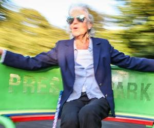 Senior lady on roundabout in playground | paul Mansfield photography/Moment Open/Getty Images