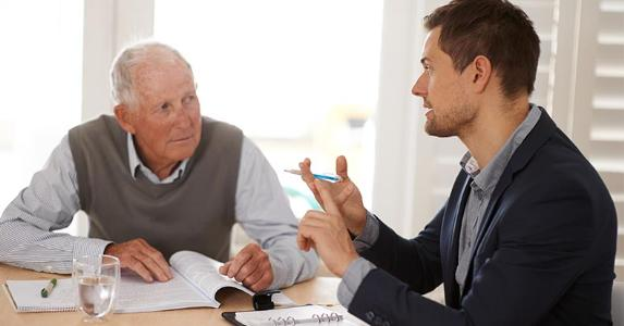Senior male client and male adviser in a meeting | PeopleImages/Getty Images