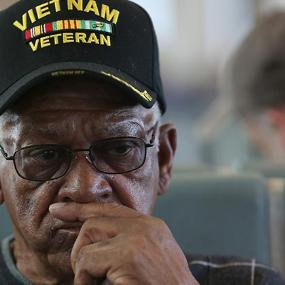Senior wearing 'Vietnam Veteran' baseball cap | Joe Raedle/Getty Images