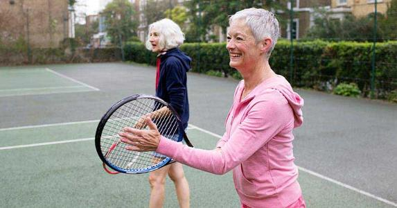 Senior women playing tennis | Nick David/Getty Images