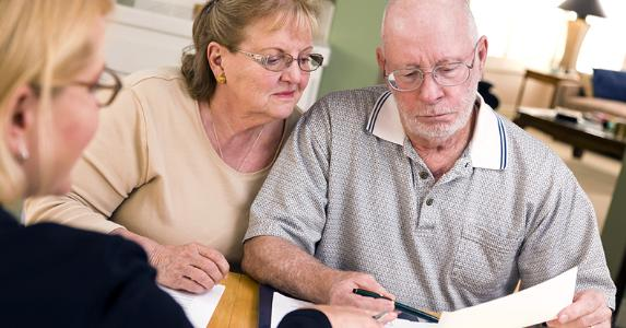 Seniors looking over document in kitchen © Andy Dean Photography/Shutterstock.com
