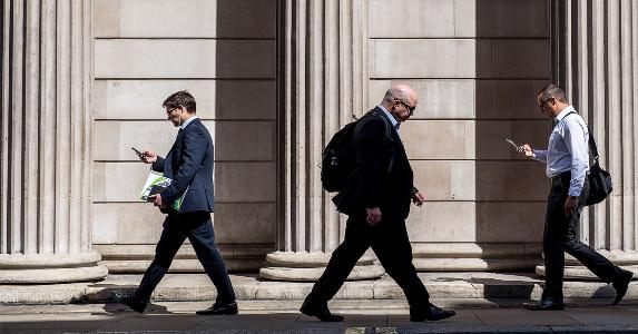 Financial workers walking down street | Bloomberg/Getty Images