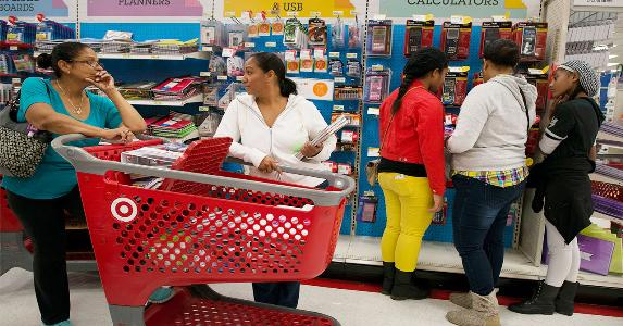 Family shopping back-to-school sales | Bloomberg/Getty Images