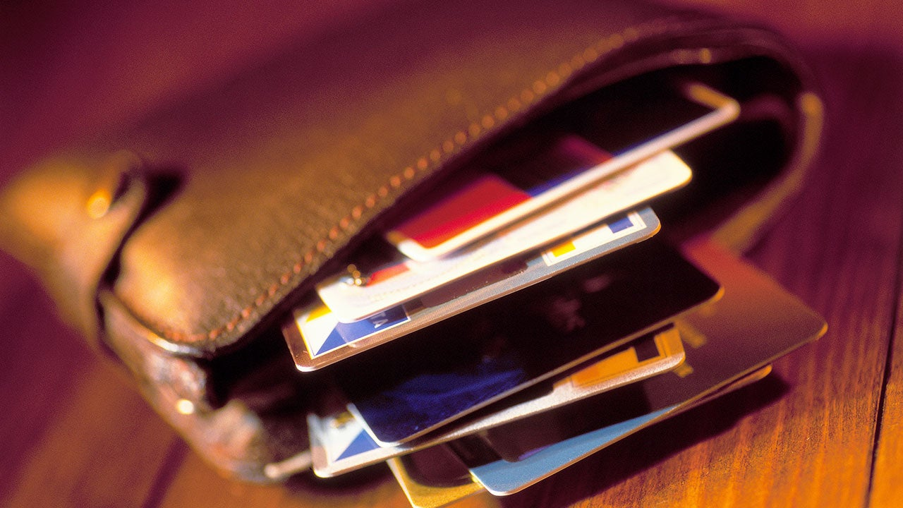 Many cards stuffed in a wallet | David Gould/Getty Images