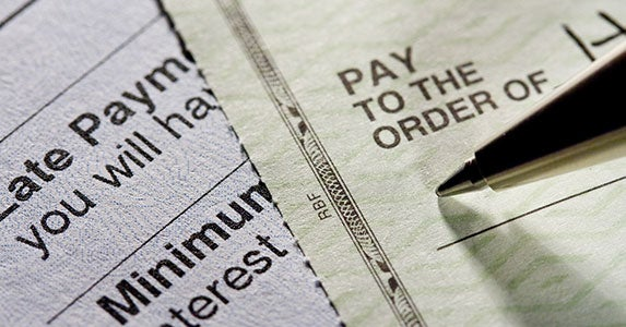 Always pay bills on time © photastic/Shutterstock.com
