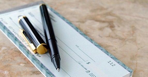 Writing 'bad' checks © NAN728/Shutterstock.com