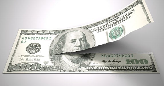 Defacing U.S. currency © iStock
