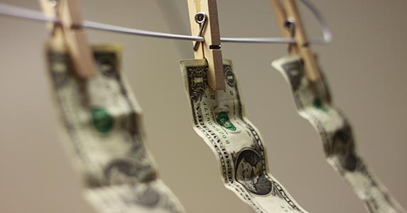 Defacing U.S. currency | Jesse D. Eriksen/Moment/Getty Images