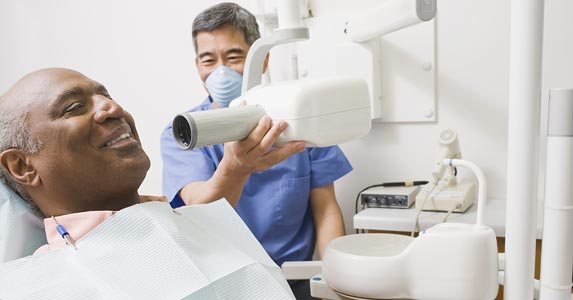 How a savings plan differs from dental insurance | Paul Simcock/Stockbyte/Getty Images