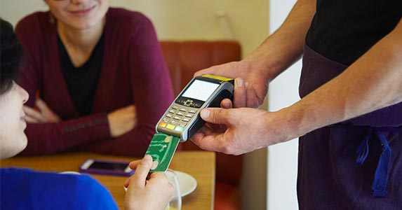 Putting credit card rates in motion | Kathleen Finlay/Getty Images