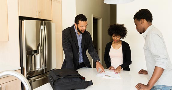 Should you buy your rental or finance it? | Roberto Westbrook/Getty Images