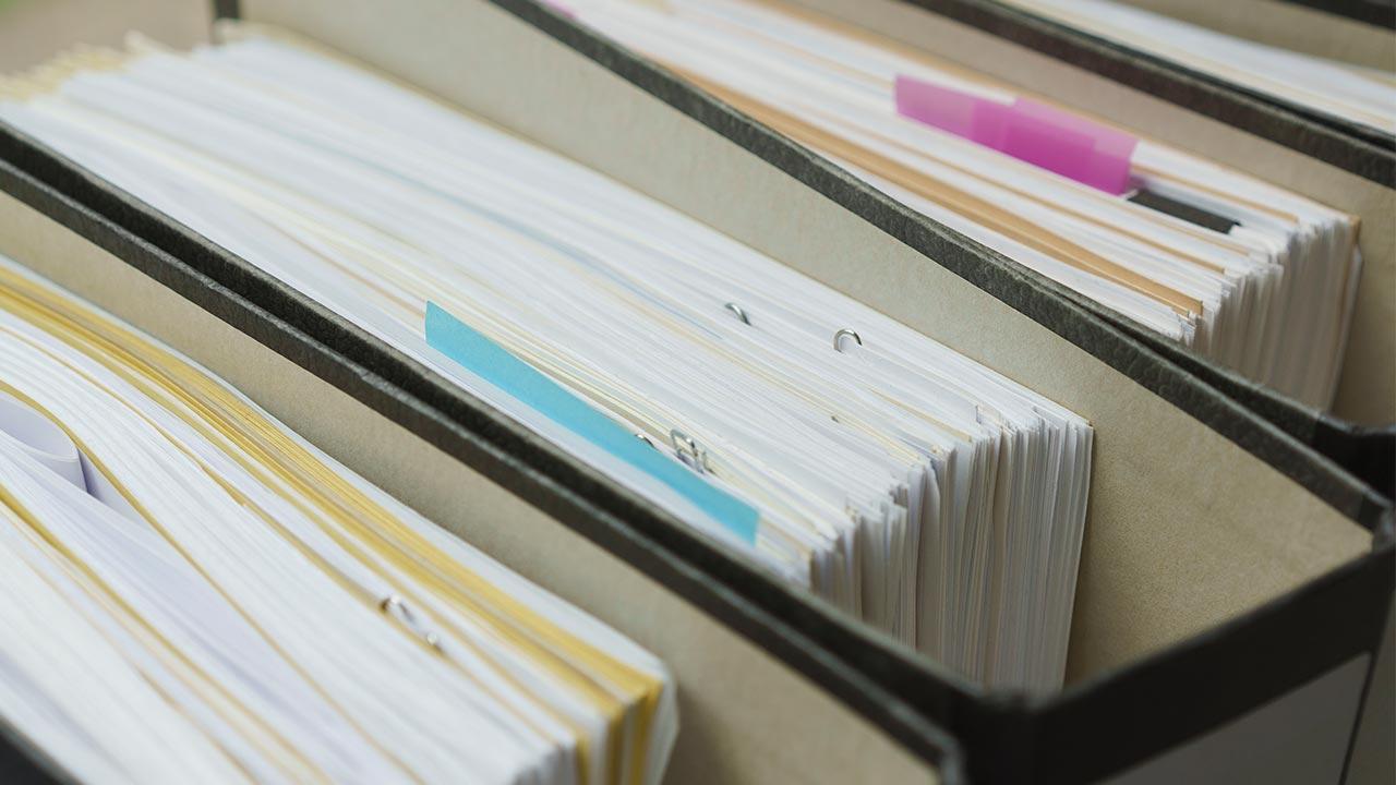 Organize documents   Halfdark/Getty Images