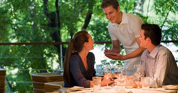 Realize eating out eats up savings | Chris Ryan/OJO Images/Getty Images