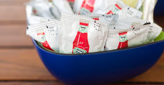 Can you save by swiping condiments? | iStock.com/cbarnesphotography