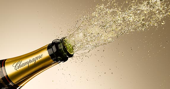 A bottle of champagne | Andy Roberts/OJO Images/Getty Images