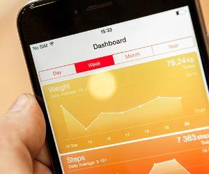 Smartphone displaying new health app © Hadrian/Shutterstock.com