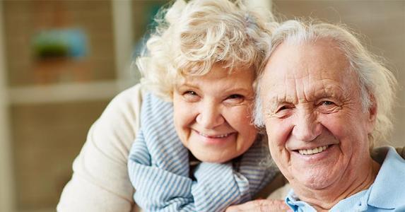Older couple posing for photo   shironosov/Getty Images