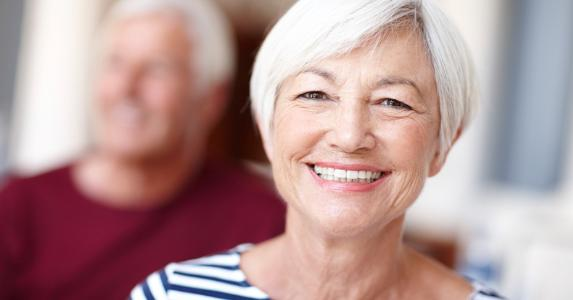 Senior woman smiling at camera © iStock