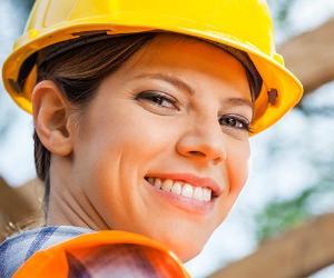 Smiling construction worker | Tyler Olson/Shutterstock.com