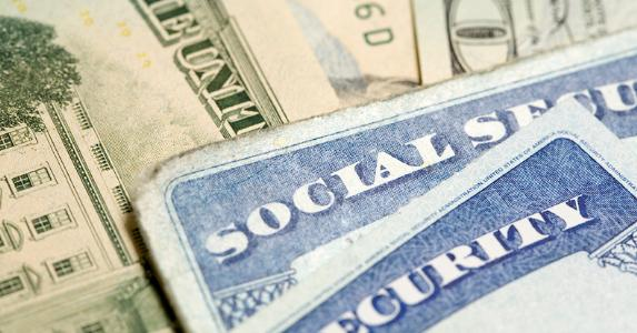 Social security cards and money © iStock