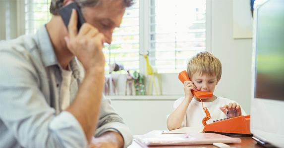 Toddler playing with toy phone | Paul Bradbury/Getty Images