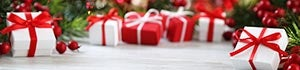 Presents wrapped in red and white paper under the tree © iStock