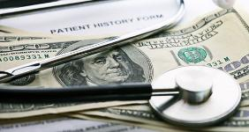 Stethoscope on 100 bills with history form © isak55/Shutterstock.com