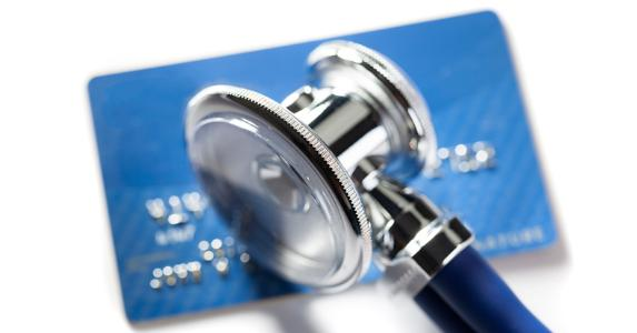 Stethoscope on credit card © iStock