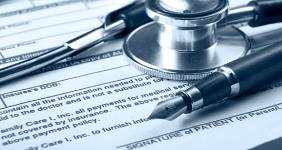 Stethoscope on medical bill blue hue  lenetstan/Shutterstock.com