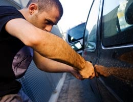 Thieves stealing car parts