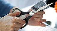 Cutting credit card in half © iStock