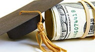 Graduation cap and rolled money © zimmytws - Fotolia.com