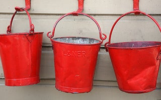 Three old red fire buckets © Shelli Jensen/Shutterstock.com