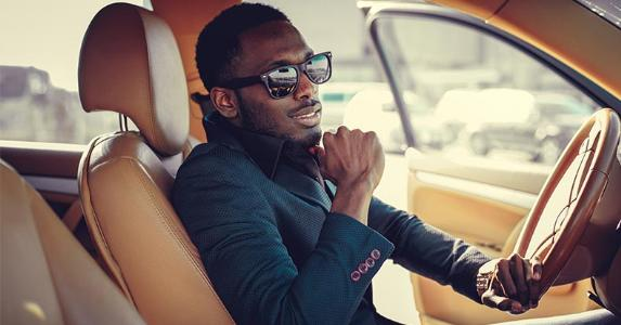 Young man driving fancy car © FXQuadro/Shutterstock.com