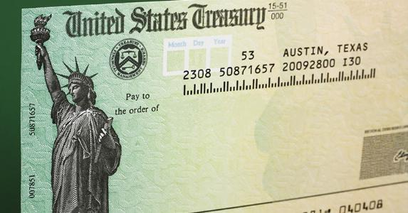 Tax refund check with green background © karen roach/Shutterstock.com