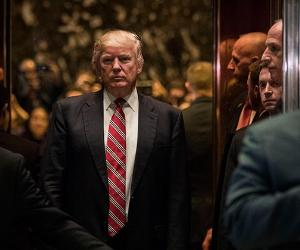 Donald Trump and entourage in elevator | Drew Angerer /Getty Images