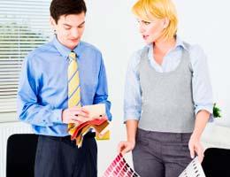 Female interior designer with client