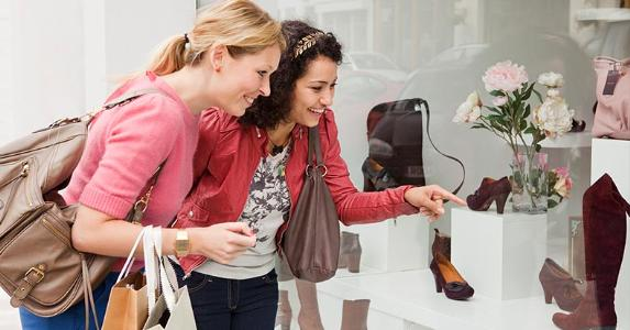 Two women shoe shopping | Betsie Van Der Meer/Getty Images