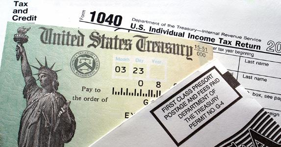 United States Treasury tax refund check and tax form | iStock.com