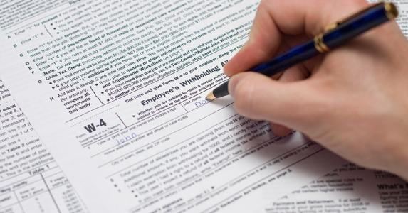 Updating Form W-4 Employee's Withholding Allowance © iStock