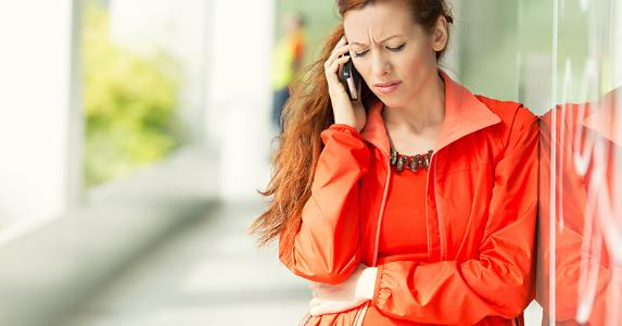 Upset woman on the phone, office background © PathDoc/Shutterstock.com