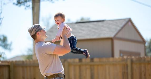 Veteran playing in yard with his daughter | Sean Murphy/Getty Images