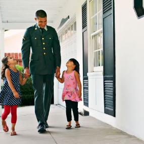 Veteran with his 2 children | Peathegee Inc/Blend Images/Getty Images