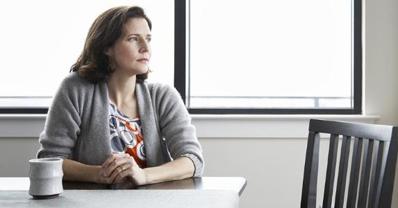 Wife sitting alone at table   mother image/DigitalVision/Getty Images